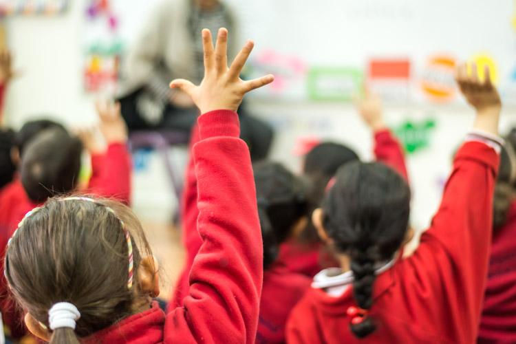 Gulf British Academy pupils raising hands